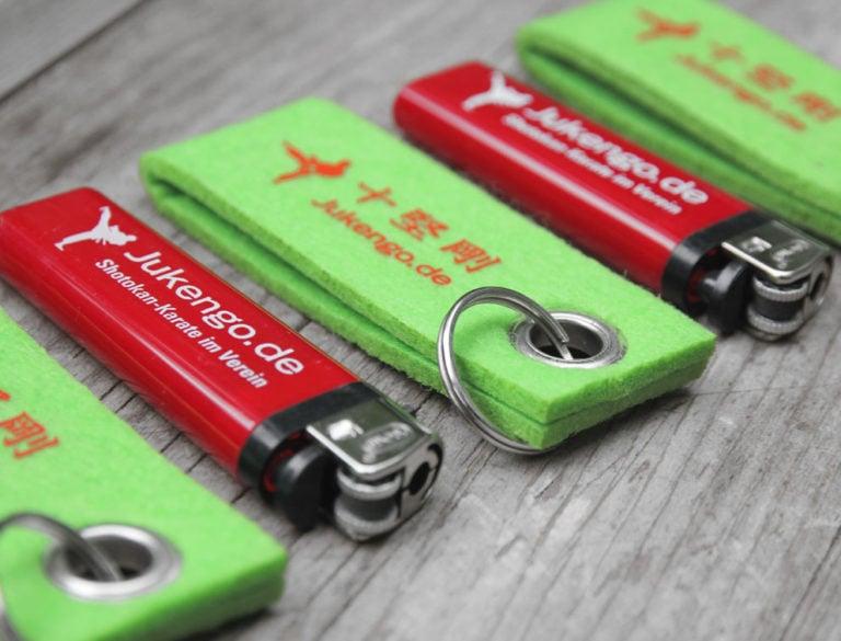 Design-Werbemittel - Grafik-Design Print Referenz Schlüsselanhänger und Feuerzeuge Werbemittel